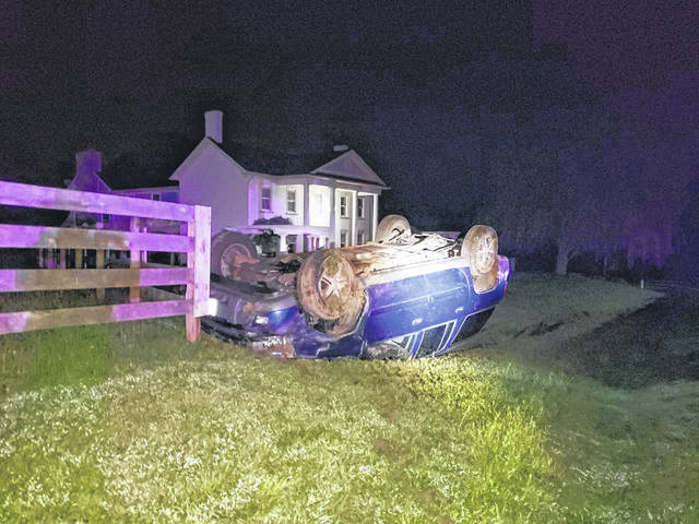 A blue 2005 Chevrolet Trailblazer, driven by Joshua Allen Bruggeman, 44, 219 N. Highland Ave., Sidney, rests on its top after a single-vehicle crash. The vehicle came to a final rest in the yard of 18894 McCloskey School Road after rolling during the crash on Friday, Aug. 23, at 1:23 a.m. Bruggeman was transported by Perry Port Salem Rescue to Wilson Health. The crash is still under investigation by the Shelby County Sheriff's Office.