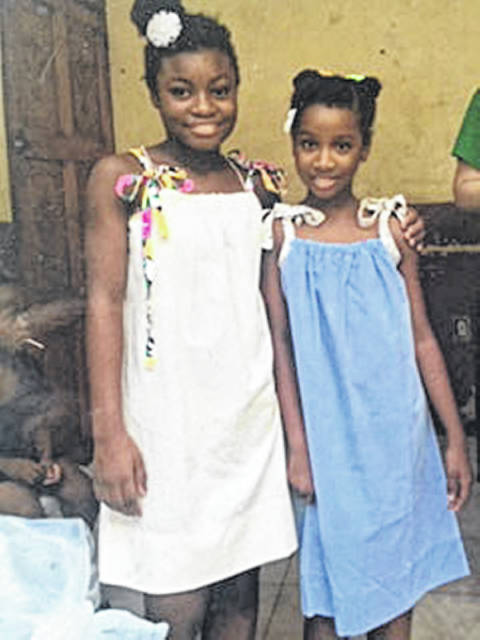 These girls received dresses made by Wrapped in God's Love volunteers.