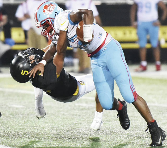 Sidney senior defensive back Darren Taborn brings down Dayton Belmont's Tavon Hardwick in the first half a nonconference game on Friday at Sidney Memorial Stadium. Taborn played in his first game this season and had 64 all-purpose yards and 8.5 tackles.