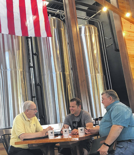 Sidney-Shelby County Bicentennial Committee Co-chairs Mike Barhorst and Bob Guillozet discuss with Nick Moeller of Moeller's Brew Barn the type of beer that could be produced for Sidney's Bicentennial celebration.