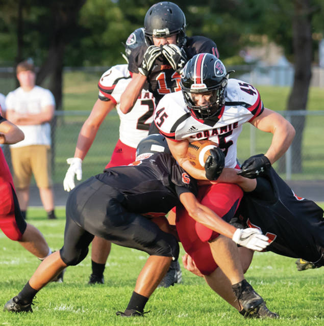 Fort Loramie junior running back Max Hoying runs during a nonconference game against Minster on Aug. 30 in Minster. The Redskins will face winless Bradford this Friday.