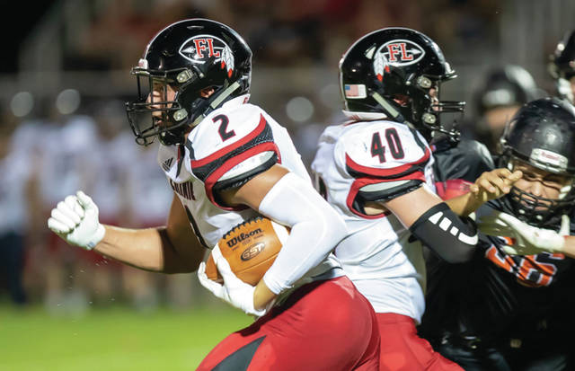 Fort Loramie senior tight end Drew Benanzer runs during a nonconference game on Friday in Minster. The Redskins, which lost 20-13, will host St. Henry on Friday.