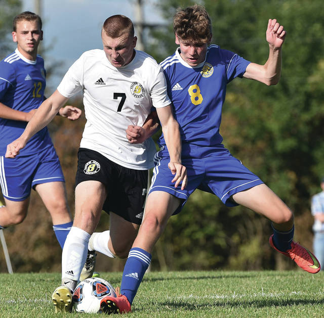 Sidney's Braden Guinther, left, and Lehman Catholic's Sam Gilardi go after the ball during a nonconference game on Thursday at Lehman Catholic.