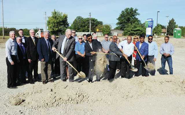 Officials from Sunrise Hospitality and Sidney Mayor Mike Barhorst ceremonially break ground for a new TownePlace Suites by Marriott on Thursday, Sept. 26.