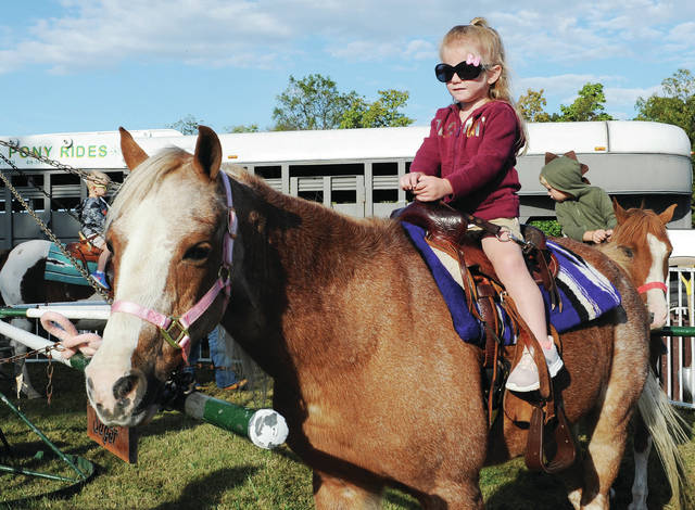 Kylee Reese, 3, of Jackson Center, daughter of Jen and Eric Reese, takes a ride on a pony during Shelby Hills' Family Fall Fun Day on Friday, Sept. 27. Kids also picked out pumpkins, went on a hayride and could hang out at a petting zoo.