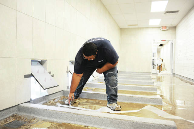 Nicacio Jesus, of Lewis Center, puts down a Cabosil fiberglass joint which allows the floor of the kennels to flex instead of cracking.