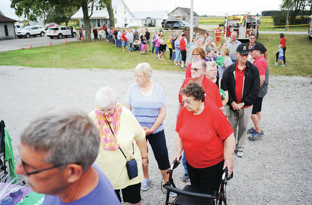 A line of people waits to eat at a benefit for Lori Clinehens to help in her fight against cancer at the Maplewood Fire Department. The benefit which included a hog roast dinner and a silent auction was held Saturday, Sept. 28.