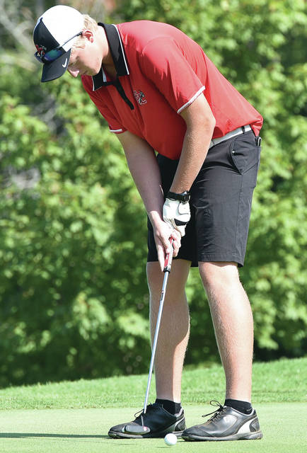 Fort Loramie's Zach Pleiman putts during the Shelby County Athletic League golf tournament on Thursday at Stillwater Valley Golf Course in Versailles. Pleiman finished first individually with a 72 and the Redskins finished first as a team with 312.