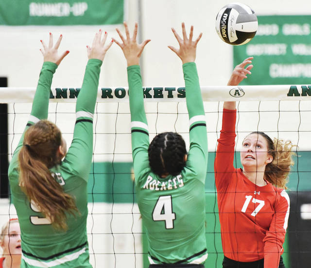 Houston's Hannah Hollinger spikes as Anna's Madison Roe and Natasha York go for a block during a Shelby County Athletic League match on Thursday in Anna.