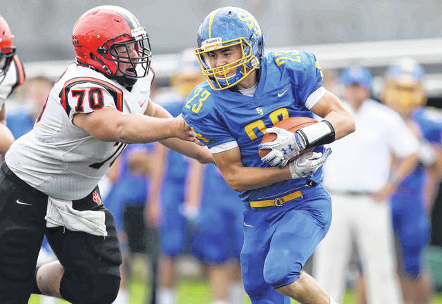 Delphos St. John's Isaac Fairchildlooks to get past Versailles' Kyle Dirksen during a Midwest Athletic Conference game on Saturday at Stadium Park in Delphos.