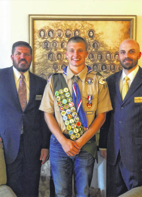 Braden Scott Guinther, center, earned the rank of Eagle Scout. Aaron Edwards, left, and Erik Edwards, right, both of Cromes-Edwards Funeral Home & Crematory, were among the people who made donations for Braden's Eagle Scout project.