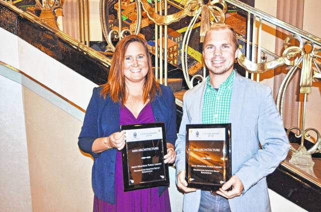 Suzanne Cline, Shelby County Libraries executive director, and Kevin Montgomery, architect with krM Architecture, accepted the awards at the American Institute of Architects Ohio Valley Region Conference.