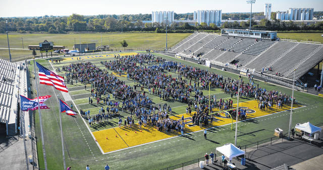 More than 2,300 students and community members filled Sidney Memorial Stadium during Wednesday's Guinness World Record attempt of having the most people opening drink cans simultaneously. The effort was successful as 2,344 people opened the drink cans, which were filled with water, in five seconds.