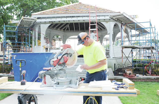 Kyle Schwieterman, of Coldwater, cuts new pieces for a railing post on the Centennial Park gazebo on Wednesday, Sept. 4. The gazebo is getting a new roof, new railing and new paint in time for Minster Oktoberfest. The gazebo sits where the first Stallostown Mission Catholic Church used to be. The church was completed in 1835.