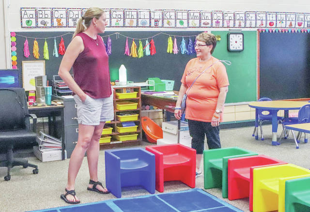 Pre K teacher Carrie Clark, left, talks with Sidney/Shelby County Chamber of Commerce member Teresa Stackonis during a Business After Hours event at Whittier Early Childhood Center on Thursday, Sept. 6. Rooms have been refreshed and taken down to a more playful preschool level.