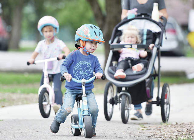 Nikki Baumer, goes for a walk at Lake Loramie State Park with her children, left to right, Haven Baumer, 4, Bently Baumer, 2, and Willa Baumer, 1, all of Minster, on Friday, Sept. 6. The family will soon be camping at the park. The kids are also the children of Jason Baumer.
