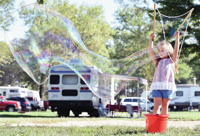 Annie Loraine-Bruns, 5, of Sidney, daughter of Heidi Loraine-Bruns, makes a giant bubble at the Lake Loramie State Park Fall Harvest Festival on Saturday, Sept. 14.