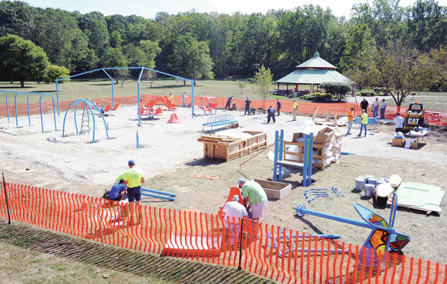 Volunteers and Shelby County Jail inmates work on the all inclusive community park at Tawawa Park on Thursday, Sept. 19.