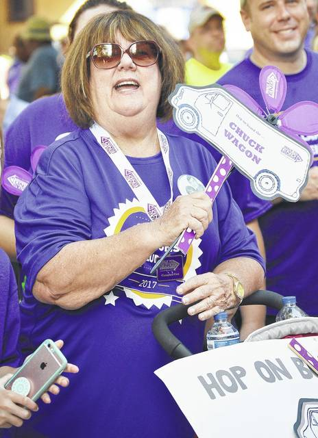 Kay Wendeln, of Russia, cheers as groups are recognized during the opening ceremony of Shelby County's 2017 Walk to End Alzheimer's. Wendeln's group, The Chuck Wagon, raised $8,730 to fight Alzheimer's in 2017. The group is named in honor of Wendeln's late husband, Charlie Wendeln.