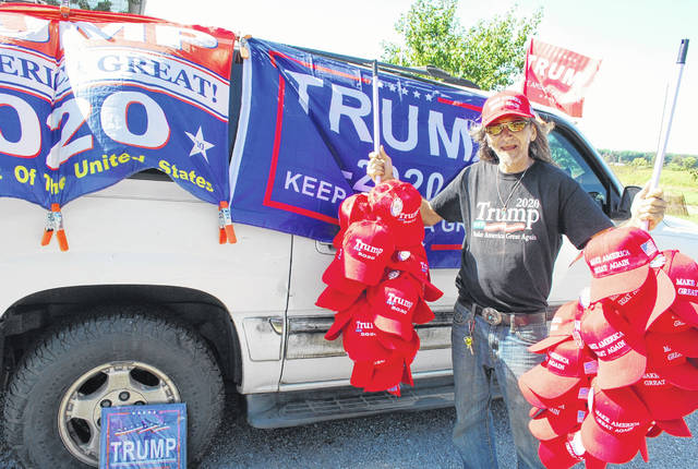 "Bob Millsaps of Gatlinburg, Tennessee, was at a flea market in Bowling Green on Saturday hawking his Donald Trump merchandise when he learned of Trump's visit to Lima and Wapakoneta on Sunday. So Millsaps set up shop at the intersection of Greely Chapel and Hanthorn roads to sell his wares. ""The best places are always near the airports,"" he said."
