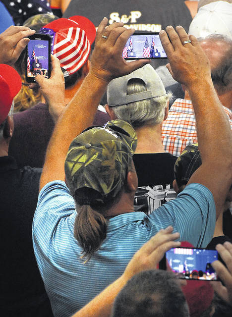 Members of the crowd at Pratt Industries hold up their phones to get a picture of President Donald Trump's speech Sunday in Wapakoneta.