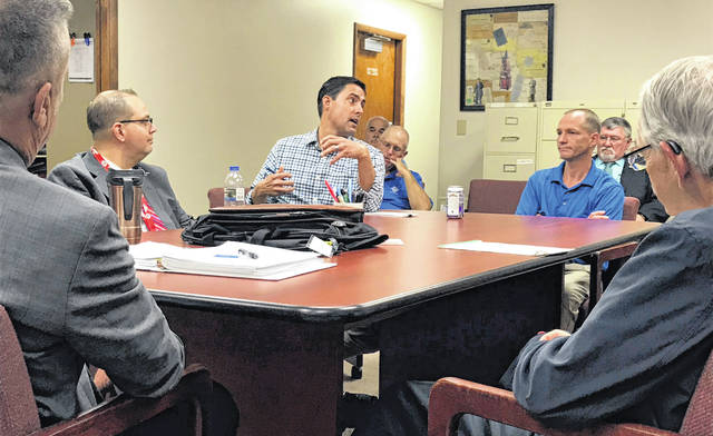 Ohio Secretary of State Frank LaRose, center, speaks to Shelby County officials during a Wednesday morning visit to the Shelby County Board of Elections.