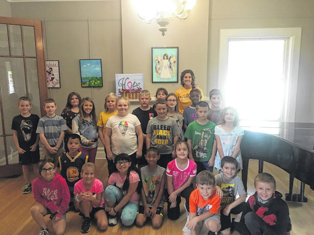 Northwood third-grade students learned more about the Bad Art by Good People fundraiser during a visit to Gateway Arts Council. Artist Julie Henman was present to talk about her entry in the fundraiser.