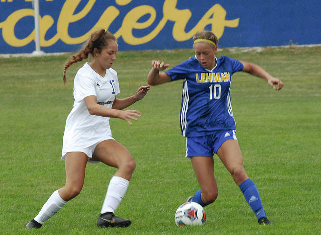 Lehman Catholic's Ella Monnin fights off Cincinnati Mariemont's Madison Schwartz during a nonconference game on Saturday in Sidney.