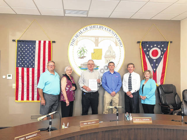Representatives of Shelby County's museums appeared recently in the Commissioner's office after receiving a copy of the Resolution of Necessity signed by the commissioners to place the .25 mill levy on the November ballot to raise funds for their organizations. Pictured left to right are Tom Woodruff (Jackson Center), Carol Carity (Anna), Jim Rosengarten (For. Loramie), Greg Geis (Botkins), Rich Wallace (levy coordinator) and Julie Gilardi (Shelby County Historical Society in Sidney).