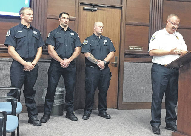 Three of Sidney Fire Department's (SFD) four new firefighters, Jared Pleiman, from left, Ken Battiston and Joshua Waugh were introduced by Fire Chief Brad Jones to Sidney City Council members during Monday evening's meeting. The fourth newest firefighter, Ross Kohler, was absent Monday due to a death in the family.