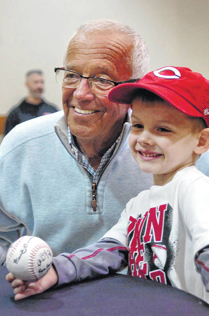 Cincinnati Reds broadcaster Marty Brennaman takes a photo Friday with fan on Jan. 24, 2017 during the Reds Caravan tour at University of Northwestern Ohio Event Center in Lima.