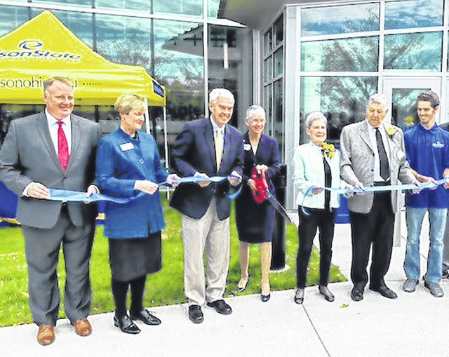 Edison State Community College President Doreen Larson, center, leads the ceremonial ribbon cutting for the college's new Robinson Student Career Center Wednesday afternoon, along with, from left to right, Jack Hershey, president and CEO of the Ohio Association of Community Colleges; Tami Baird Ganley, chair for the Edison State Community College Board of Trustees; Pat and Thom Robinson; and Dylan Warren, Edison State Student Senate director of administration.