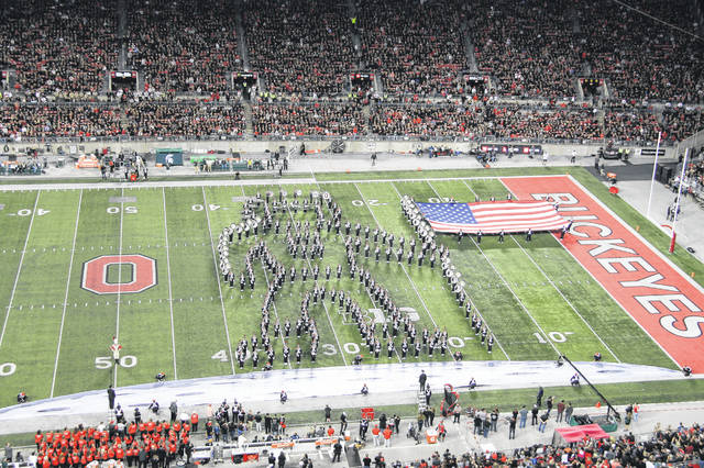 """Neil Armstrong"" places the U.S. flag on the moon during the halftime performance by the Ohio State University Marching Band. The band paid tribute to the 50th anniversary of the first man walking on the moon."