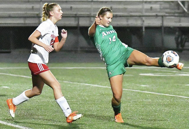 Anna's Taylor Noll redirects the ball with pressure from a Milton-Union player during a Division II district semifinal on Thursday at Northmont High School's Premiere Health Stadium.