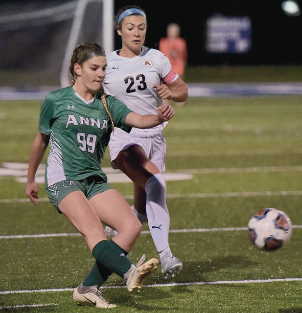 Anna's Breonna Tribbett passes the ball while covered by Alter's Anna Sweeney during a Division II district final on Thursday in Brookville.