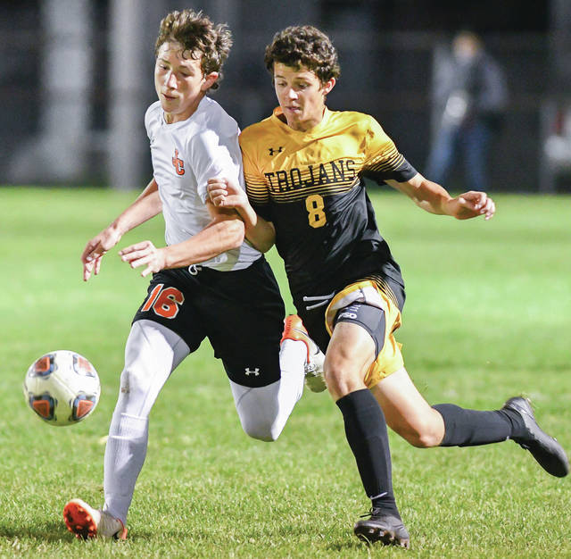 Botkins' Nathan Schneider, right, and Jackson Center's Bryson Roberts in the first half of a Division III district semifinal on Tuesday at Wertz Stadium in Piqua. Schneider had one assist for the Trojans.
