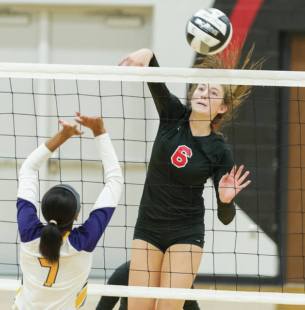 Fort Loramie's McKenzie Hoelscher spikes during a Division IV sectional semifinal against Dayton Christian on Oct. 20, 2018 in Covington. Hoelscher, a junior, was named the Shelby County Athletic League's player of the year.