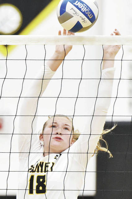 Sidney's Anna Brady goes for a block during a Miami Valley League Valley Division game against West Carrollton on Wednesday in Sidney.