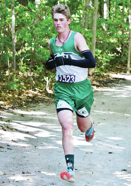 Anna's Lucas Smith runs during the Shelby County Athletic League meet on Saturday in Botkins. Smith finished first in the boys race in 16:36.