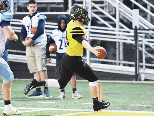 Sidney senior quarterback Ryan Dunham scores late in the first quarter of a Miami Valley League game on Friday at Sidney Memorial Stadium.