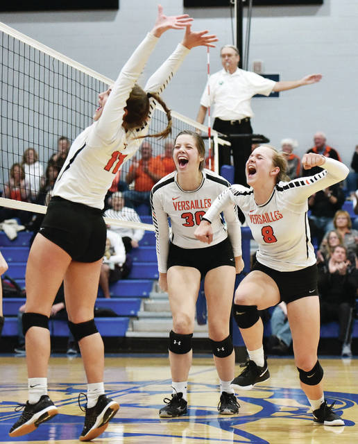 Versailles players celebrate after scoring the final point in a 3-0 win over Anna in a Division III district semifinal on Tuesday at Brookville High School. The squad, which has won D-III championships the last two years, will play in its seventh consecutive district final on Saturday.