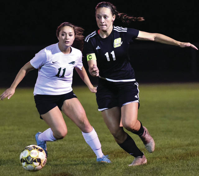 Sidney' defender Katelyn Burden gets ahead of Greenville's Eliza Wysong during a Miami Valley League game on Wednesday in Sidney. Burden is one of three seniors on the team. All three are defenders.