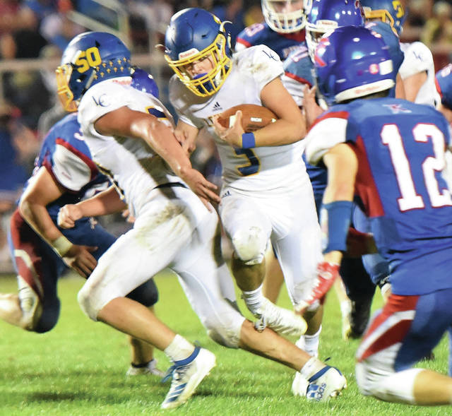 Lehman Catholic's R.J. Bertini runs during a Northwest Central Conference game against Riverside on Sept. 20 in De Graff. Bertini has thrown for 952 yards with nine touchdowns and nine interceptions and has rushed for 207 yards and three TDs.