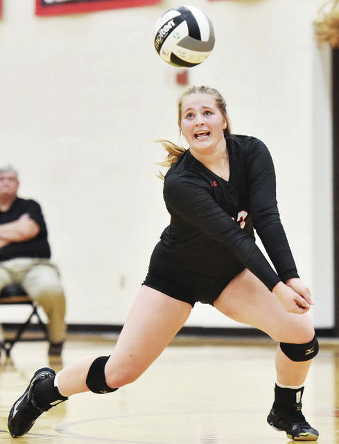 Fort Loramie's Macy Imwalle goes for a bump during a Shelby County Athletic League volleyball match against Russia on Sept. 19 in Fort Loramie. The Redskins were voted the No. 1 seed in the Troy Division IV district.