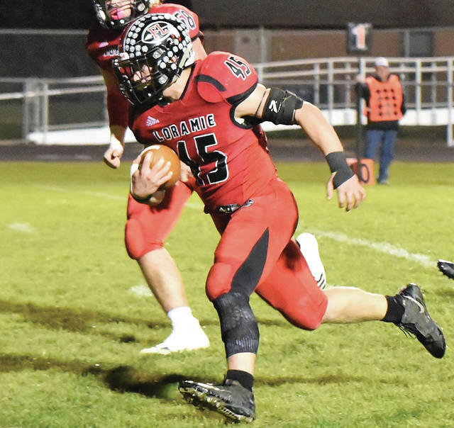 Fort Loramie's Max Hoying runs during a touchdown run in a Cross County Conference game against Mississinawa Valley on Friday in Fort Loramie. The Redskins can secure a first-round home playoff game by winning out and finishing 9-1 according to Drew Pasteur's Fantastic50.net.