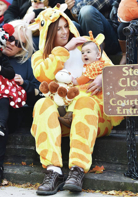 Amy Buehler dressed as a giraffe to match the costume of her daughter, Aria Buehler, 6 months, both of Sidney, in the Sidney Alive costume contest at the Downtown Sidney's Fall Festival on Saturday, Oct. 12. Aria is also the daughter of Andy Buehler.