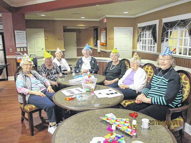 Residents of Elmwood of New Bremen prepare for the upcoming Oktoberfest in Minster by making famous Alpine hats, feathers and all. The ladies had a enjoyable time talking about the festivities of celebrating in October and all good eats and attire.