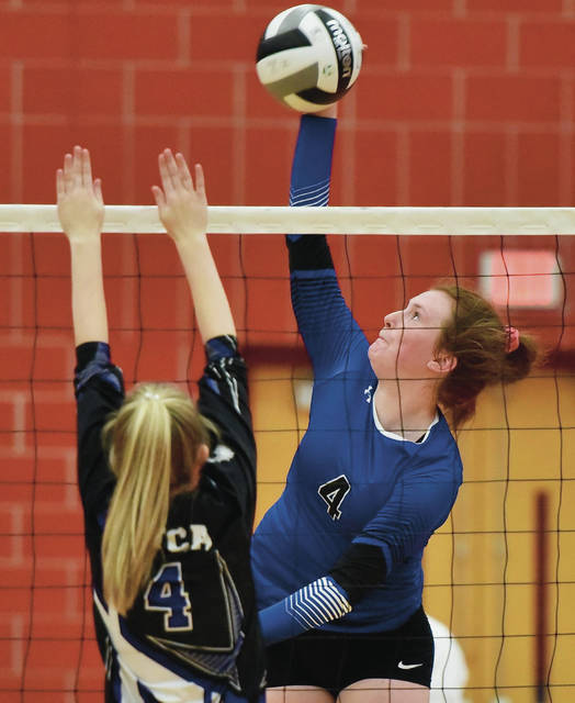 Fairlawn's Jessie Abke spikes as Miami Valley Christian Academy's Alexa Bailey tries to block during in a Division IV district final on Saturday at Troy High School's Trojan Activities Center. Abke led the squad with 14 kills on Saturday.