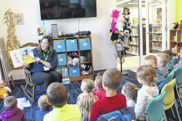 "April Osborne, Amos Public Library youth coordinator, reads ""Pete the Cat"" to the pre-k students from Fairlawn Local School Tuesday at the library. Teacher Casie Piper and her students took a field trip to the library."