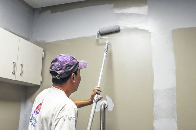 Steve Belt with C2 Enterprises in Sidney is doing some drywall and painting Tuesday at the new Bob Sargeant and Family Shelby County Animal Shelter and Adoption Center. A ribbon cutting ceremony and open house is planned for Nov. 10.